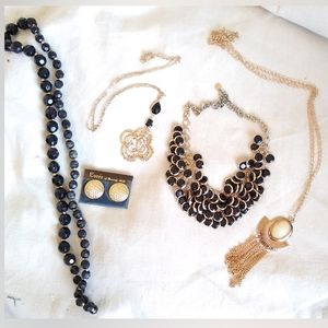 4 necklaces 1 earrings. all black and gold tone